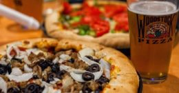 A beer with your Woodstock's pizza